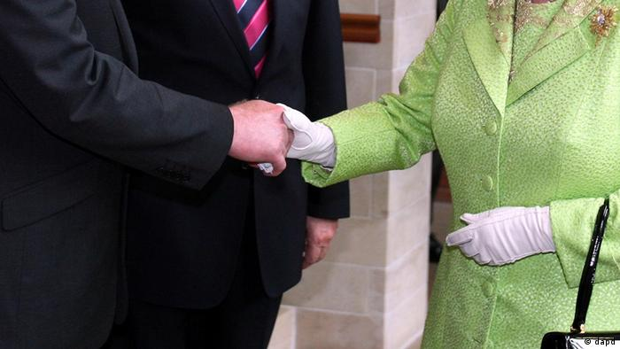 A close-up said to show the glasped hands of McGuinness and the queen