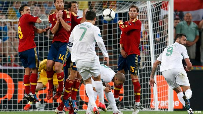 Spain's team players defend their goal as Portugal's Cristiano Ronaldo (C) takes a free kick during their Euro 2012 semi-final soccer match at the Donbass Arena in Donetsk, June 27, 2012. REUTERS/Alessandro Bianchi (UKRAINE - Tags: SPORT SOCCER)