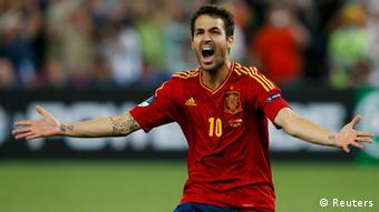 Spain's Cesc Fabregas reacts after scoring the winning penalty goal against Portugal during the penalty shoot-out in their Euro 2012 semi-final