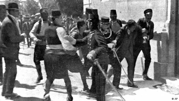 Bosnian Serb nationalist Gavrilo Princip, right, is captured by police and taken to the police station in Sarajevo, Yugoslavia, June 28, 1914, after he assassinated the Archduke Franz Ferdinand, heir to the Austrian-Hungarina throne, and his wife. Princip, 19, who has tuberculosis, died four years later in prison. (ddp images/AP Photo)