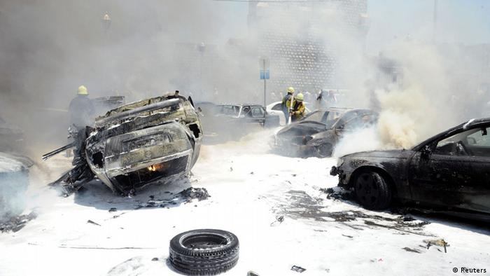 Civil Defence members extinguish fires on cars at the site of an explosion outside Syria's highest court in central Damascus June 28, 2012. The explosion tore through the car park outside the court on Thursday, torching at least 20 cars, a Reuters witness said, but it was not immediately known if there were any casualties. REUTERS/SANA/Handout (SYRIA - Tags: POLITICS CIVIL UNREST) FOR EDITORIAL USE ONLY. NOT FOR SALE FOR MARKETING OR ADVERTISING CAMPAIGNS. THIS IMAGE HAS BEEN SUPPLIED BY A THIRD PARTY. IT IS DISTRIBUTED, EXACTLY AS RECEIVED BY REUTERS, AS A SERVICE TO CLIENTS