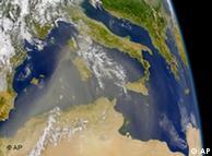 A satellite image showing a large plume of Saharan Desert blowing northeastward across Europe