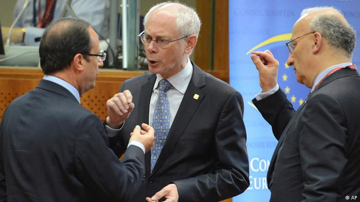 Van Rompuy (centre) in animated discussion with two European leaders at a summit in Brussels