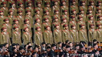Members of the North Korean People's Army sing a song at a ceremony in Pyongyang