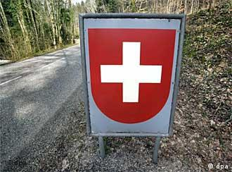 A sign marking the Swiss border