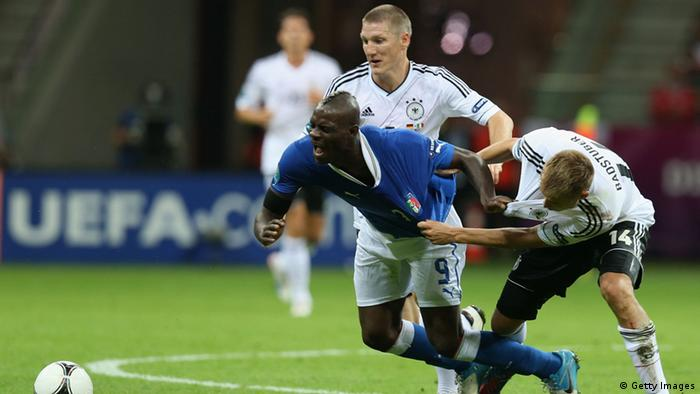 WARSAW, POLAND - JUNE 28: Holger Badstuber (R) of Germany and Mario Balotelli of Italy during the UEFA EURO 2012 semi final match between Germany and Italy at National Stadium on June 28, 2012 in Warsaw, Poland. (Photo by Alex Grimm/Getty Images)