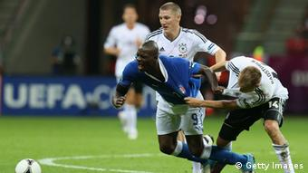Holger Badstuber (R) of Germany and Mario Balotelli of Italy during the UEFA EURO 2012 semi final match between Germany and Italy at National Stadium on June 28, 2012 in Warsaw, Poland.