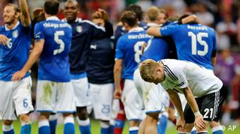 Germany's Marco Reus stands dejected after the Euro 2012 soccer championship semifinal match between Germany and Italy in Warsaw, Poland, Thursday, June 28, 2012.