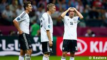 Germany's Miroslav Klose (L), Bastian Schweinsteiger (C) and Philipp Lahm react after the Euro 2012 semi-final soccer match against Italy at National Stadium in Warsaw, June 28, 2012. REUTERS/Kai Pfaffenbach (POLAND - Tags: SPORT SOCCER)