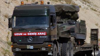 A Turkish military truck transports a mobile missile launcher to the Syrian border, near Kilis, Turkey