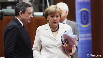 European Central Bank (ECB) President Mario Draghi (L) talks to Germany's Chancellor Angela Merkel