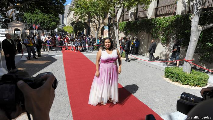 A picture of Lindiwe Mazubuko walking on a red carpet