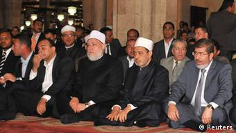 Egypt's president-elect Mohamed Mursi attends Friday prayer at al-Azhar mosque in the old quarter of Cairo (Reuters)