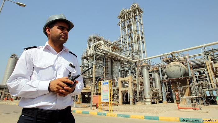 An Iran guard stands in front of a petrochemical complex in Mahshahr in the province of Khuzestan in the southwest of Iran.