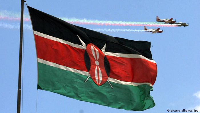 Close-up of the Kenyan flag with planes flying overhead. Photo: STEPHEN MORRISON +++(c) dpa