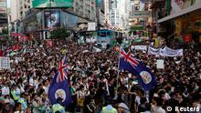 Thousands of protesters, some carrying Hong Kong colonial flags, crowd a street urging new Hong Kong leader Leung Chun-ying to step down at Hong Kong's shopping Causeway Bay district July 1, 2012, during the 15th anniversary of the territory's handover to China. Leung was sworn into office on Sunday by Chinese President Hu Jintao for a five-year term in which he will confront challenges ranging from human rights to democracy after a tumultuous year of transition and protest. REUTERS/Bobby Yip (CHINA - Tags: POLITICS ANNIVERSARY CIVIL UNREST)