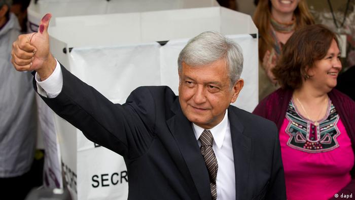 Mexican presidential candidate Andres Manuel Lopez Obrador of the Democratic Revolution Party (PRD) shows his election ink-stained thumb after casting his vote at a polling station in Mexico City, Sunday, July 1, 2012.