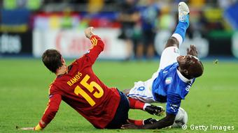 KIEV, UKRAINE - JULY 01: Sergio Ramos (L) of Spain slides in to tackle Mario Balotelli of Italy during the UEFA EURO 2012 final match between Spain and Italy at the Olympic Stadium on July 1, 2012 in Kiev, Ukraine. (Photo by Jasper Juinen/Getty Images)