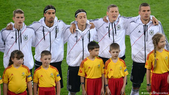Germany's Lars Bender, Sami Khedira, Mesut Oezil, Bastian Schweinsteiger and Lukas Podolski (L-R) during the national anthem before UEFA EURO 2012 group B soccer match Denmark vs Germany at Arena Lviv in Lviv, the Ukraine, 17 June 2012. Photo: Thomas Eisenhuth dpa (Please refer to chapters 7 and 8 of http://dpaq.de/Ziovh for UEFA Euro 2012 Terms & Conditions)