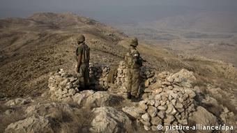 Pakistani soldiers secure an area on top of Kund mountain near Kotkai village in South Waziristan, 29 October 2009. Pakistani security forces launched a large-scale offensive to eliminate the Taliban and al-Qaeda network in the South Waziristan tribal region on 17 October 2009. Eight German nationals thought to be Islamist militants were killed Monday night, October 04, 2010 in a strike by a suspected US unmanned drone in Pakistan. The pilotless aircraft fired two missiles at a house in Pakistan's tribal region along the Afghan border, Pakistani security officials said. The group was believed to be behind the recently uncovered plot to carry out terrorist attacks in Britain, France and Germany.