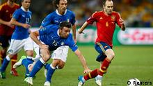 Spain's Andres Iniesta (R) challenges Italy's Andrea Barzagli during their Euro 2012 final soccer match at the Olympic stadium in Kiev, July 1, 2012. REUTERS/Kai Pfaffenbach (UKRAINE - Tags: SPORT SOCCER)
