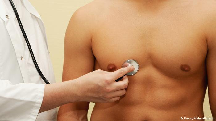 A doctor examining a man's chest