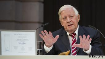 REFILE - CORRECTING TITLE OF HELMUT SCHMIDT Former German Chancellor Helmut Schmidt gestures after he received the Eric Warburg Award from the NGO Atlantic Bridge at the German Historical Museum in Berlin, July 2, 2012. The non-governmental organisation Atlantic Bridge honours people with the Eric M. Warburg Award for their achievements in promoting the German-American friendship, its website said. REUTERS/Thomas Peter (GERMANY - Tags: POLITICS)