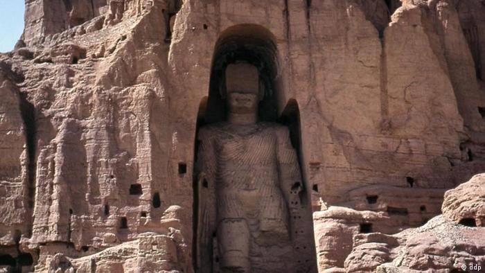 -The world's tallest statue of Bhudda, measuring 53 meters (175 feet), is shown in Bamiyan, 125 kilometers west of Kabul in Afghanistan in 1973. Supreme Commander of the Taliban Mullah Mohammad Omar ordered the destruction of all pre-Islamic statues in Afghanistan, including centuries-old Buddha in Bamiyan. Hamid Karzai said his government will rebuild giant statues of Buddha that were destroyed by the Taliban in 2000. (CP PHOTO - Mildred Dearborn)