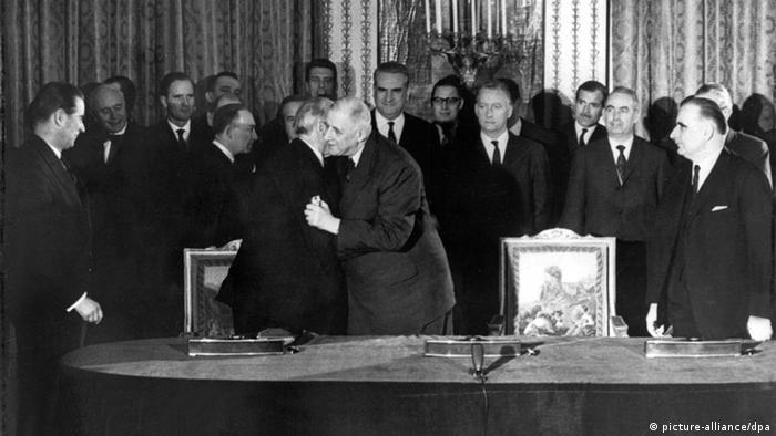 de Gaulle and Adenauer embrace after signing the treaty