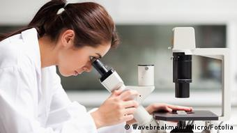 Focused female science student looking in a microscope © WavebreakmediaMicro #35348146