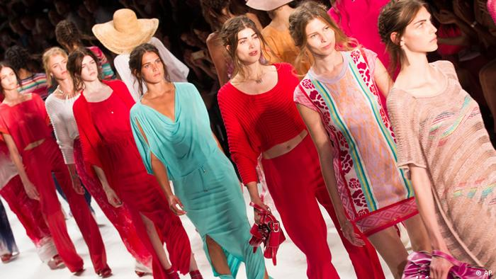 Models present creations of the fashion label Escada Sport at the Fashion Week for spring summer 2013 in Berlin, Wednesday, July 4, 2012. (AP Photo/Markus Schreiber)