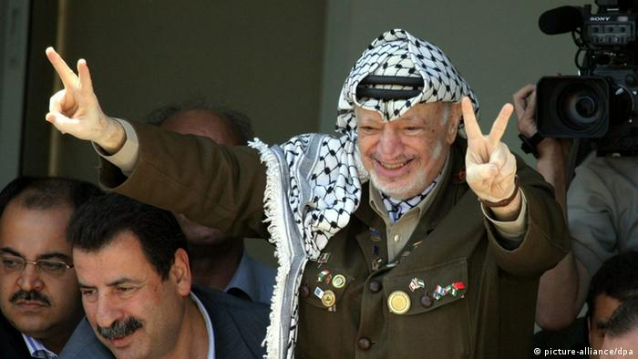 Palestinian leader Yasser Arafat greets his supporters September 13, 2003 in Ramallah, West Bank.