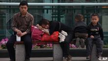 Migrant workers take a rest at the Tianfu Square in Chengdu in southwest China's Sichuan province on Sunday, March 21, 2010.(Photo By Evens Lee/Color China Photo/ddp images/AP Images)