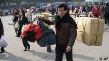 A migrant worker nears the train station in Guangzhou, southern China's Guangdong province, Thursday, Jan. 8, 2009. Some 188 million Chinese are expected to squeeze onto China's train network in the coming weeks to return home for the Chinese Lunar New Year. (ddp images/AP Photo/William Foreman)