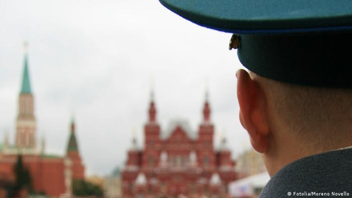 A man whose head is turned away from the camera and who's wearing a military cap looks out Moscow. (Photo: © Moreno Novello #10349448 - Fotolia.com)