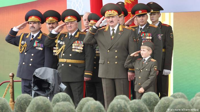 MINSK, BELARUS. JULY 3. 2011. Belarusian President Alexander Lukashenko (foreground R) reviews troops during a military parade to mark the country_s main state holiday _Independence Day. At right is his son Nikolai. (Photo ITAR-TASS / BelTa)