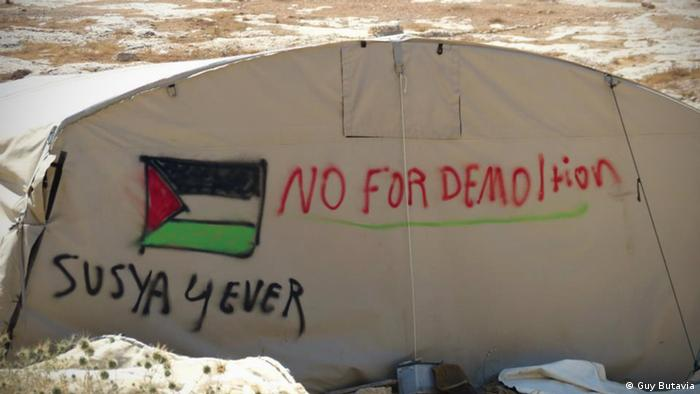 The villagers of Susya have sprayed their tents with anti-demolition slogans