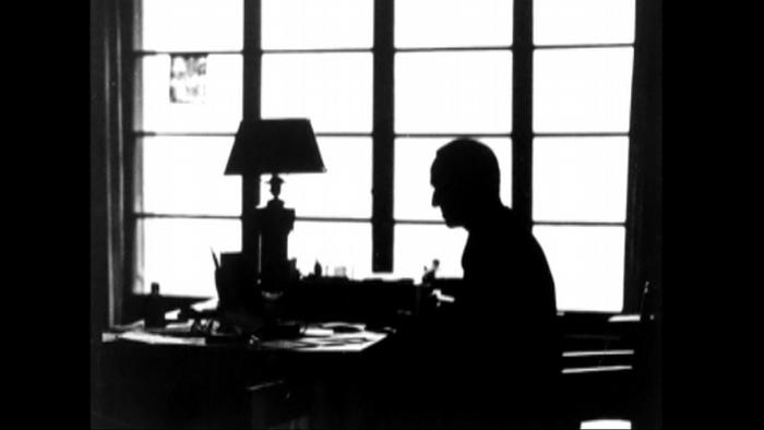 A silhouette of Hermann Hesse at his desk