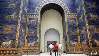 Visitors going through the Ishtar Gate at a Babylon exhibition in Berlin (AP Photo/Franka Bruns)