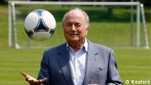 International Federation of Football Association (FIFA) President Sepp Blatter poses with a ball on a local soccer pitch in Zurich July 4, 2012. The International Football Association Board (IFAB) will hold a meeting on goal line technology on July 5, at the Home of FIFA in Zurich. REUTERS/Michael Buholzer (SWITZERLAND - Tags: SPORT SOCCER)