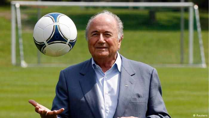 International Federation of Football Association (FIFA) President Sepp Blatter poses with a ball on a local soccer pitch in Zurich (Photo: REUTERS/Michael Buholzer)
