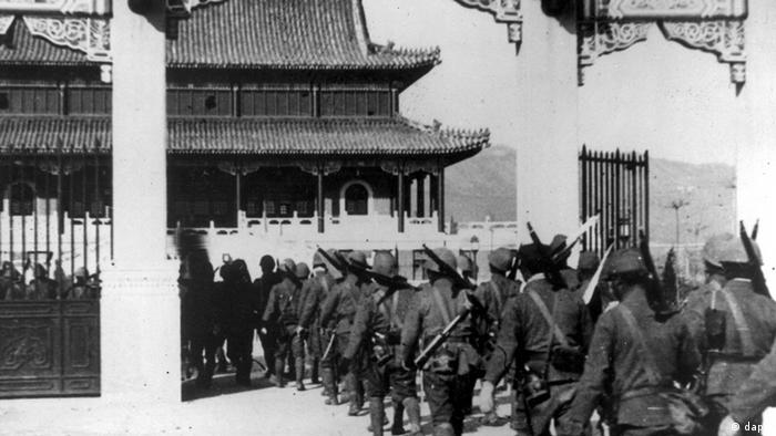 Japanese troops march into a Chinese government building used as barracks after the capture and occupation of Nanking, captial city of China, during the Second Sino-Japanese War in Jan. 1938. (ddp images/AP Photo)