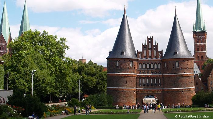 No other Hanseatic town has such a distinctive cityscape. The old trading station and residential buildings, with their network of alleyways and courtyards, are guarded by the world famous Holstentor, pictured here.