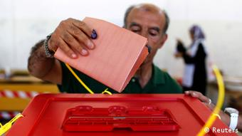 A man casts his vote at a polling station in Benghazi July 7, 2012. REUTERS/Youssef Boudlal
