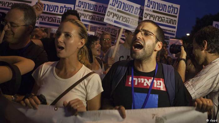 Israelis attend a rally in Tel Aviv
