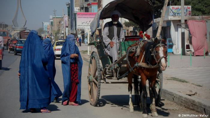 Afghan women traveling with a horse cart
