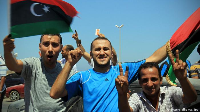 Libyans celebrate the vote in the National Congress elections at the corniche road (seaside road), in Benghazi, Libya, 07 July 2012. (c) dpa