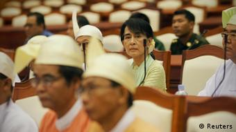 Myanmar pro-democracy leader Aung San Suu Kyi attends a parliamentary meeting at the Lower House of Parliament in Naypyitaw July 9, 2012. REUTERS/Soe Zeya Tun (MYANMAR - Tags: POLITICS)