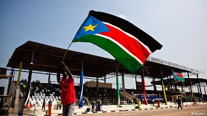 A man waves the national flag of South Sudan. (Photo: REUTERS/Adriane Ohanesian)