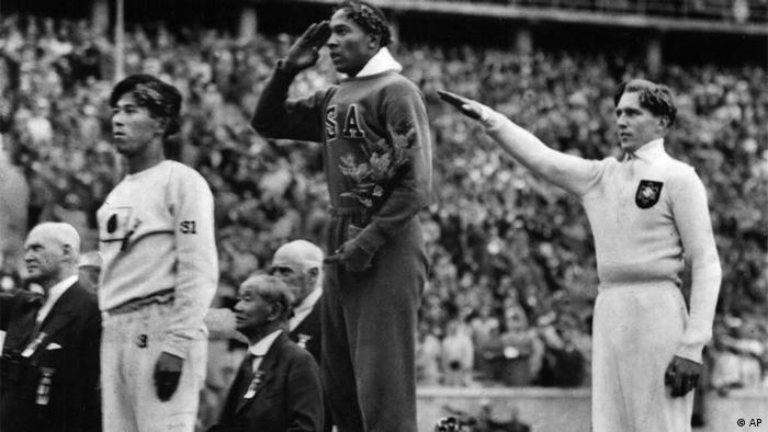Jesse Owens on the podium after winning one of four gold medals at the 1936 Berlin Olympic Games. Photo: ddp/AP